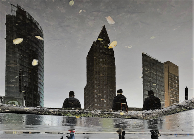 Potsdamer Platz  puddle reflection highrise buildings Berlin - berlininfo Guided tours